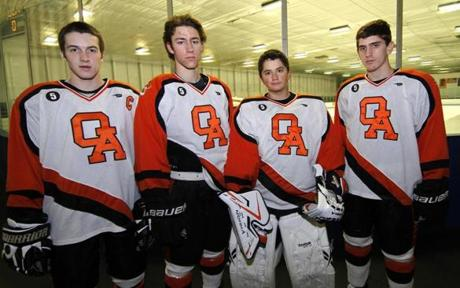 5.0.758332909_Regional_19sohockey Oliver Ames High hockey players Sean Kyne, Justin Davidner, goalie Jimmy Tierney and Andrew Mancini pose before the game against Franklin High in Brockton, Mass., Saturday, Jan. 14, 2012. (Robert E. Klein for The Boston Globe)